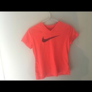 One Nike shirt and one green shirt
